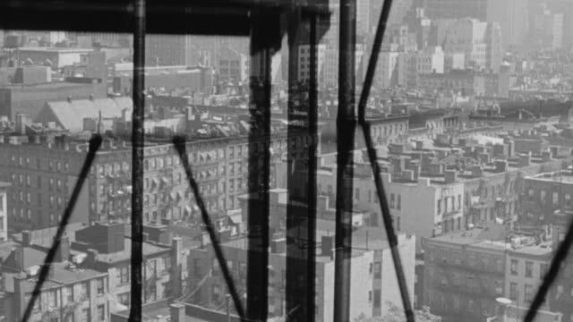 ms tu shot of illusion of ascending in open elevator overlooking city tenement district - fahrstuhlperspektive stock-videos und b-roll-filmmaterial