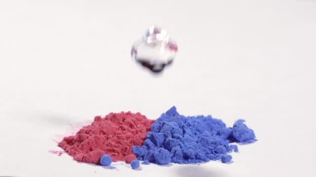 CU SLO MO Shot of impact of drop falling into holi colors / Munich, Bavaria, Germany