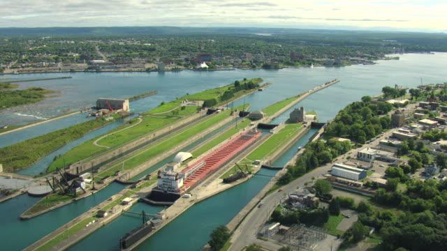 ms aerial shot of  indiana harbor in locks at soo locks / sault ste marie, michigan, united states - lago superiore video stock e b–roll
