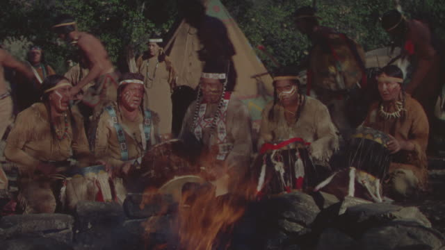 ms shot of indians people enjoying at night in front of fireplace - north american tribal culture stock videos and b-roll footage