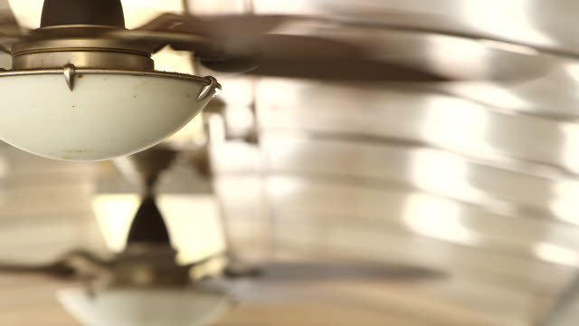 shot of indoor fans attached to the ceiling of a 1950's diner in new york - klimaanlage stock-videos und b-roll-filmmaterial