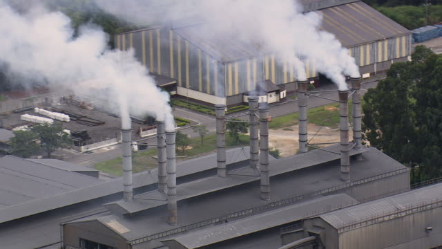 ms aerial shot of industrial site / minas gerais, brazil - 工場の煙突点の映像素材/bロール