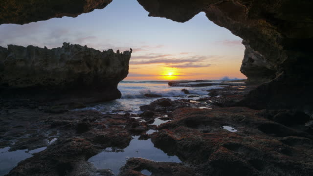stockvideo's en b-roll-footage met ws t/l shot of inside ocean cave with sunrise / arniston, western cape, south africa - grot