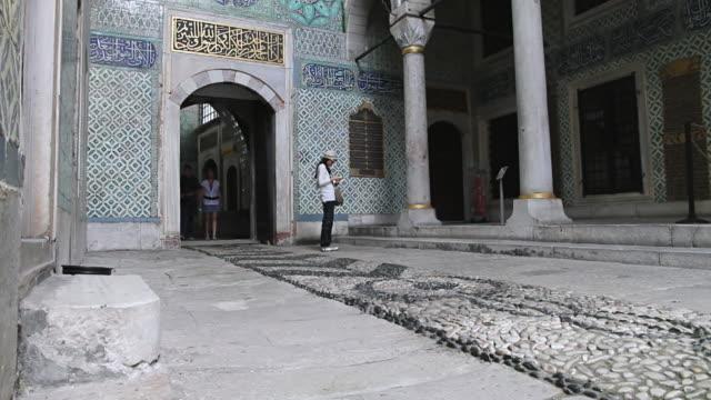 ms shot of inside of topkapi palace museum with tourists / turkey - museum stock videos & royalty-free footage