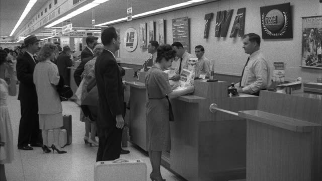 ms shot of interior miami airport terminal at ticket desk - 1960 stock-videos und b-roll-filmmaterial