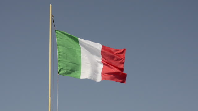 MS Shot of Italian Flag moving in wind / Forte dei Marmi, Tuscany, Italy