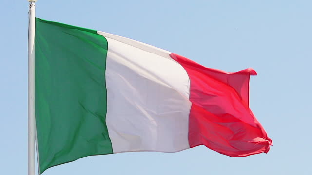 MS SLO MO Shot of Italian Flag Waving in Wind / Caen, Normandy, France