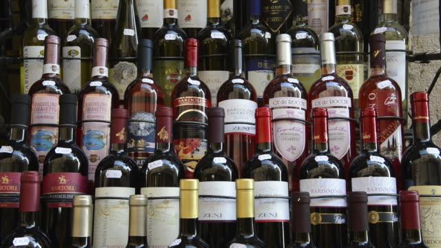 MS Shot of Italian wine bottles in front of shop / Bardolino, Verona, Italy