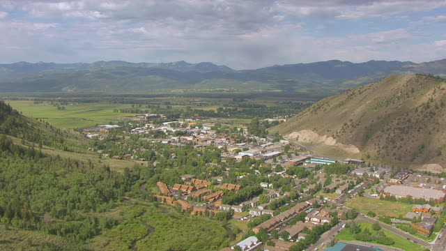 ws aerial shot of jackson hole valley / jackson wyoming united states - jackson hole stock-videos und b-roll-filmmaterial