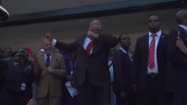 shot of jacob zuma dancing and singing at a rally outside durban high court kwazulunatal - unschuld stock-videos und b-roll-filmmaterial