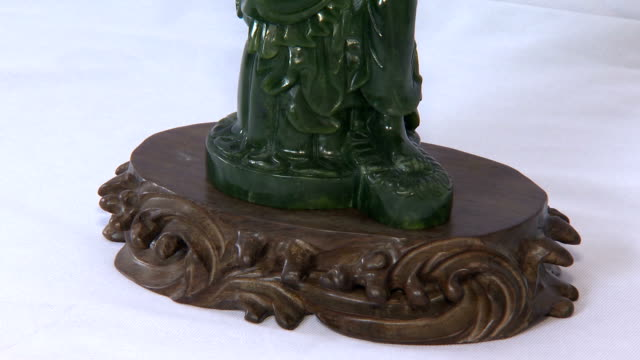 shot of jade statue of the buddha - jade stock videos & royalty-free footage