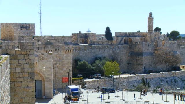 ms pan shot of jaffa gate and tower of david from old city wall / jerusalem, judea, israel - gerusalemme video stock e b–roll