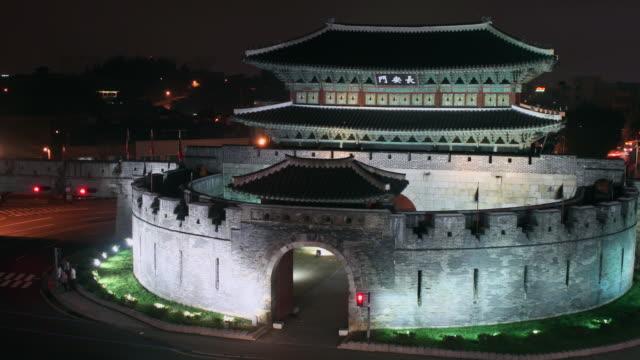 ms t/l shot of janganmun gate in suwonhwasung castle (unesco heritage) / suwon, gyeonggi-do, south korea - suwon stock videos and b-roll footage