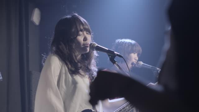 ms pan shot of japanese rock band playing on stage / taipei, taiwan, china - punk music stock videos & royalty-free footage