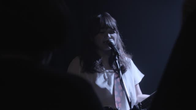 MS Shot of Japanese Rock band playing on stage / Taipei, Taiwan, China