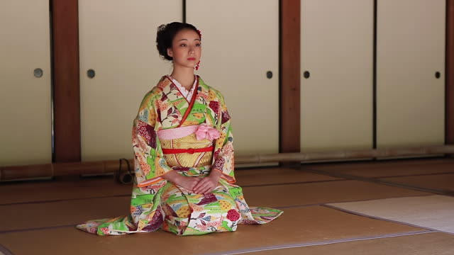 ms shot of japanese woman with kimono bowing, japanese style sitting on tatami floor / yamaguchi, yamaguchi prefecture, japan  - social grace stock videos & royalty-free footage