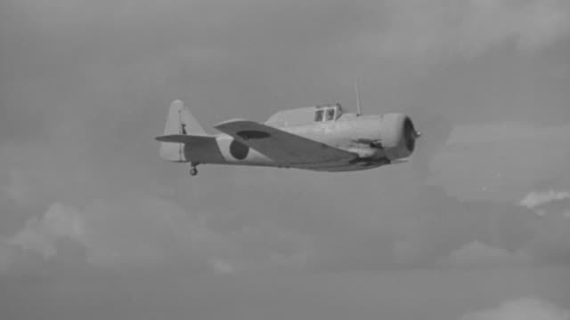 CU TS Shot of japanese zero airplane in flight from left to righ