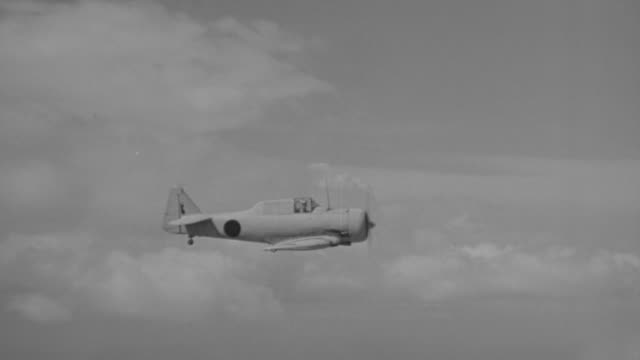 MS TS Shot of japanese zero airplane in flight from left to right