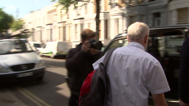 shot of jeremy corbyn leaving his home in islington and entering a taxi - islington stock videos & royalty-free footage