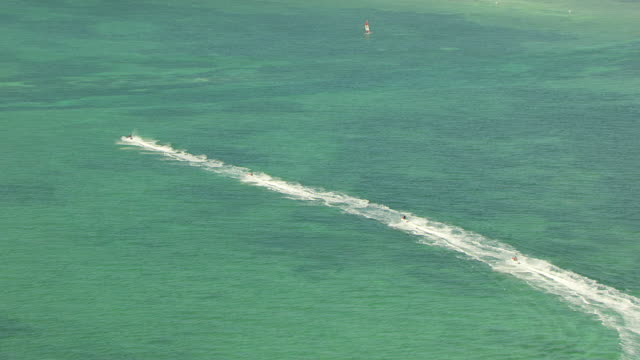 ms aerial shot of jet ski posse moving in water in key west / key west, florida, united states - acquascooter video stock e b–roll
