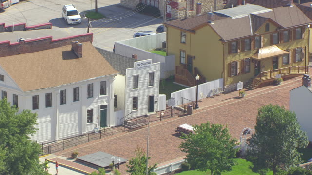 ms aerial shot of jm clemens law office across street from mark twains boyhood home on hill street / hannibal, missouri, united states - mark twain stock videos & royalty-free footage
