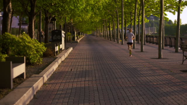 Shot of joggers running along the Hudson River on a sunny morning in Hoboken