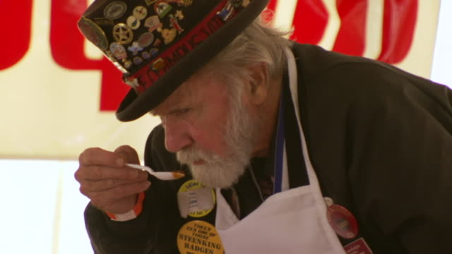 cu tu shot of judge smells and tasting sample of chili during worlds championship chili cook off / omaha, nebraska, united states - chilli con carne video stock e b–roll