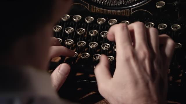 ECU TU TD Shot of Keys of typewriter as detective types / United States