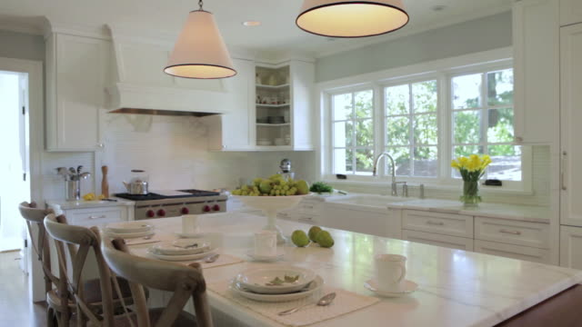 ms pan shot of kitchen in stylish home / lake oswego, oregon, united states - fashionable stock videos & royalty-free footage