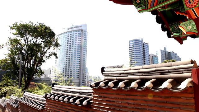 Shot of Korean Traditional Stone Wall in Bongunsa Temple and Skyscrapers behind it
