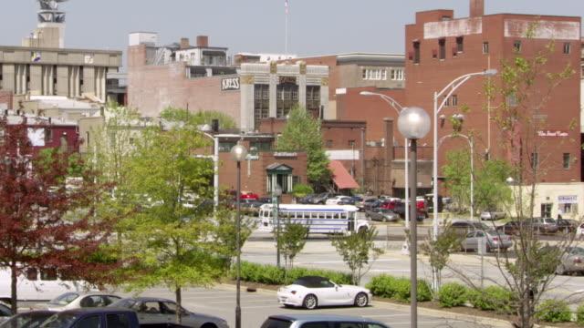 ms zo shot of kress and schiffmans buildings with downtown city / greensboro, north carolina, united states - ノースカロライナ州点の映像素材/bロール