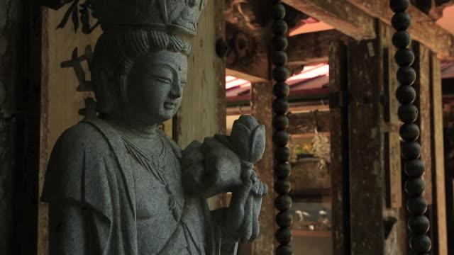 ms shot of ksitigarbha and its sounds at mount  treasures / misasa, tottori prefecture, japan  - 像点の映像素材/bロール