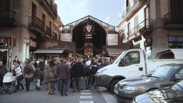 WS TD Shot of La boqueria marquet façade to crowd / Barcelona, Catalunya, Spain