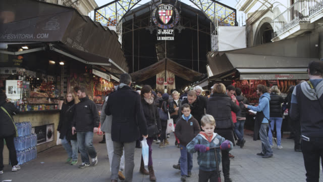 WS Shot of La boqueria marquet façade to crowd / Barcelona, Catalunya, Spain