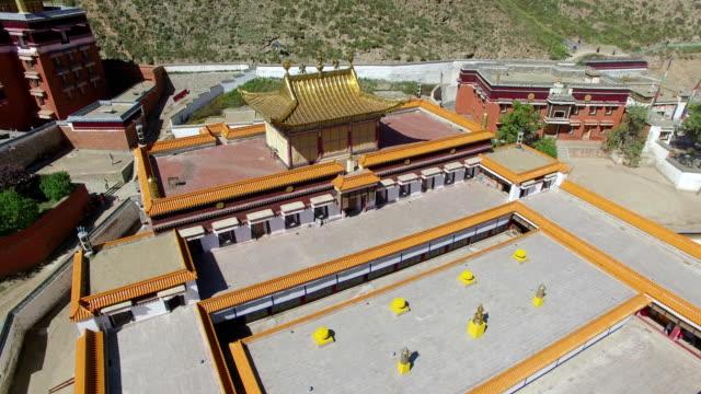ws aerial shot of labrang lamasery/gansu, china - lamasery stock videos and b-roll footage