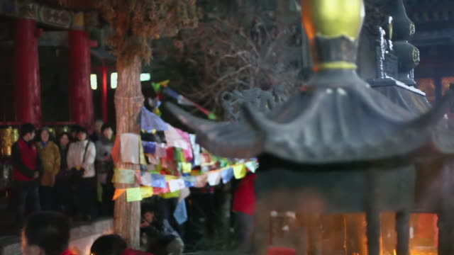 ms pan shot of lamas and believer pray for good luck at ceremony in temple / xian, china - traditional ceremony stock videos & royalty-free footage