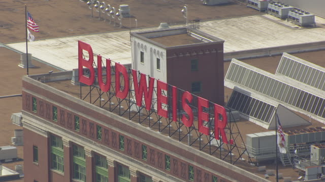 MS AERIAL Shot of Large Budweiser sign at Anheuser Busch brewery / St Louis, Missouri, United States