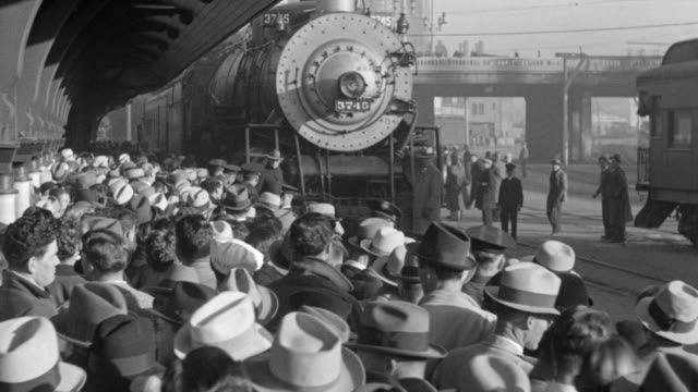 WS Shot of Large crowd of people waiting for team to arrive by train