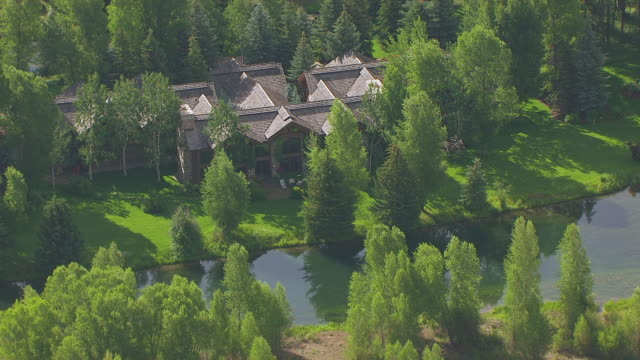 WS AERIAL TS ZI Shot of large house at Billionaire Row with Snake River / Jackson Wyoming United States