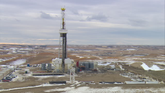 WS AERIAL Shot of large oil drilling rig in Bakken oil field near Watford City / Watford City, North Dakota, United States