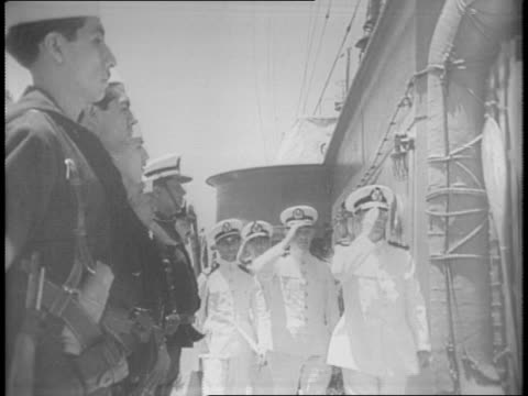 shot of large ship / close shot of mexican navy official admiral hurtado de mendoza talking to sailors / men walking on deck being saluted by sailors... - 船の一部点の映像素材/bロール