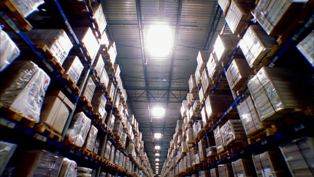 ws td t/l shot of large stacks of goods stored on warehouse shelves / lebec, california, united states - compartment stock videos & royalty-free footage