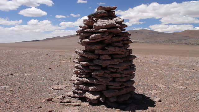 MS Shot of large tower looking stone structure in middle of desert / Road from San Pedro de Atacama to Salar de Tara, Atacama desert, Chile