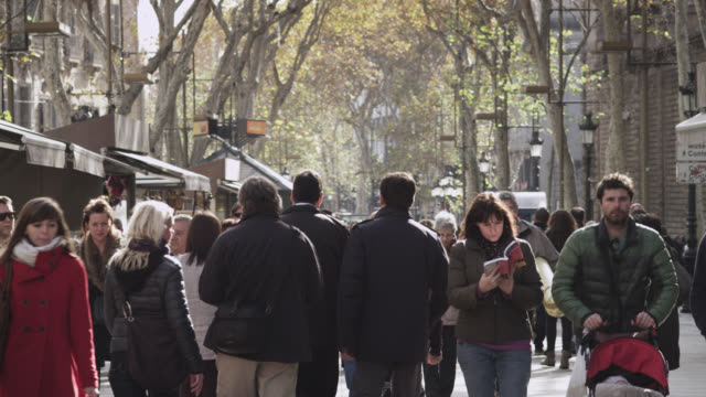 MS TU Shot of Las ramblas with crowd to trees / Barcelona, Catalunya, Spain