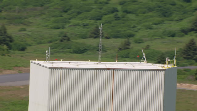 CU AERIAL TU ZO Shot of launch buildings at Kodiak Launch Complex / Kodiak Island, Alaska, United States