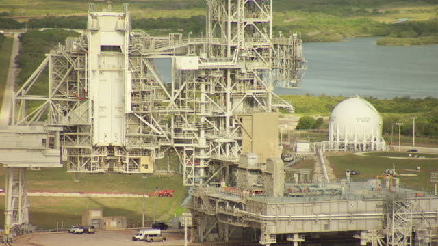 ms aerial tu shot of launch pad with ocean in at kennedy space center / florida, united states - kennedy space center stock-videos und b-roll-filmmaterial