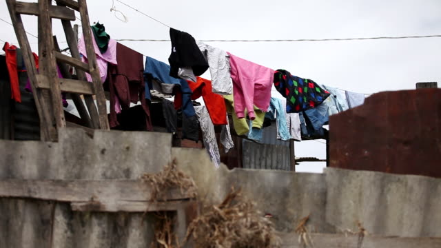 ms shot of laundry hanging to dry in clothes line outside a house in ciudad bolivar slum / bogota, colombia - bogota stock videos & royalty-free footage