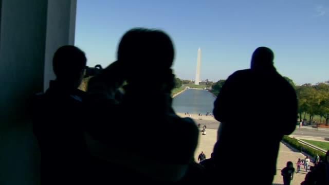 MS PAN Shot of Left behind columns and tourists at Lincoln Memorial and Reflecting Pool and Washington Monument / Washington, District of Columbia, United States