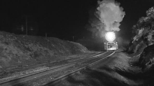 ws shot of length of railroad tracks as train approaches towards camera - steam train stock videos & royalty-free footage