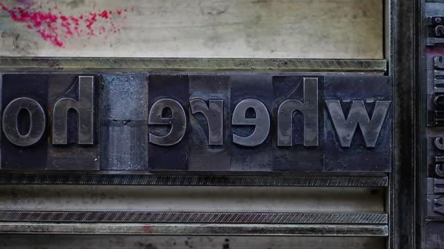 """ecu shot of letter press type spelling out """"where home is"""" / london, united kingdom  - maskinskriven text bildbanksvideor och videomaterial från bakom kulisserna"""